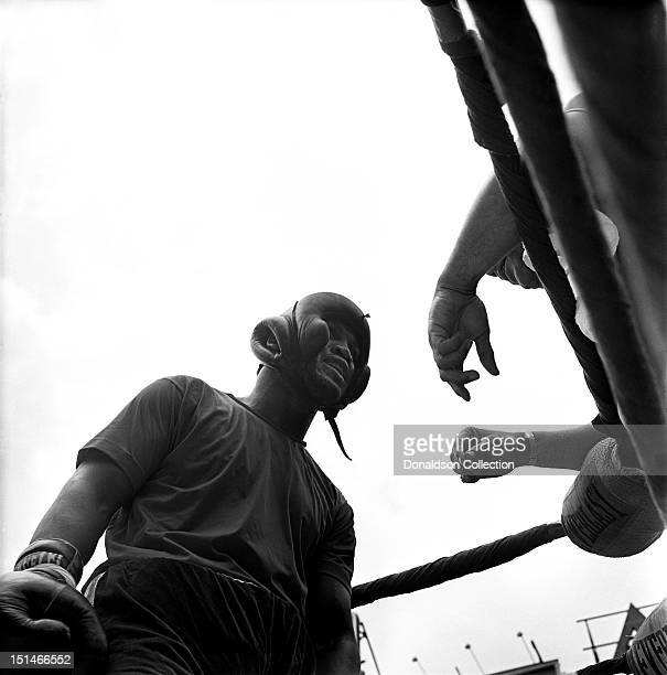 Heavyweight contender Joe Frazier with trainer Eddie Futch prepares for his fight against Jerry Quarry on June 16 1969 in New York City New York
