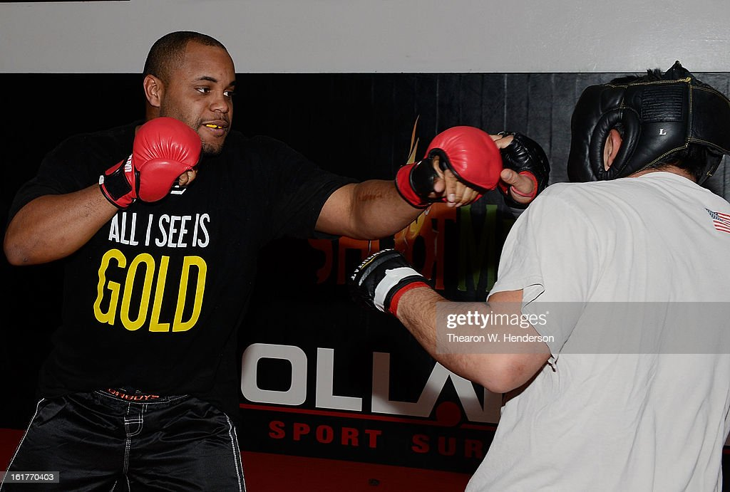 Heavyweight fighter Daniel Comier (L) works out at AKA San Jose on February 15, 2013 in San Jose, California.