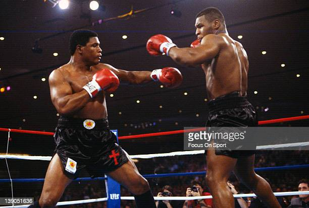 Heavyweight fighter Mike Tyson right fights Trevor Berbick left in a scheduled twelve round WBC heavyweight title fight at the Hilton Hotel in Las...