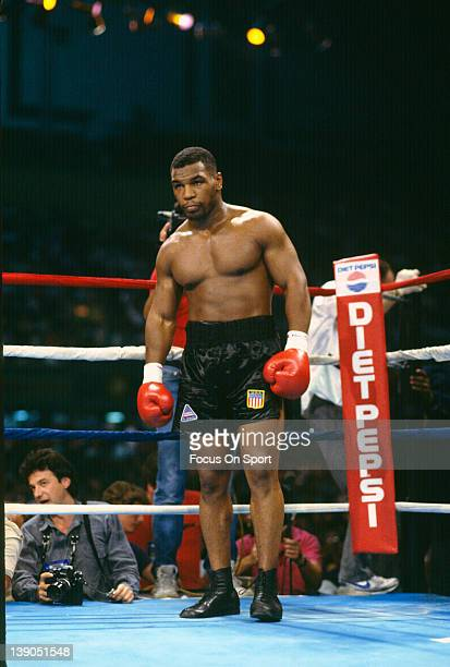 June 27: Heavyweight fighter Mike Tyson stands in his corner during a scheduled twelve round WBC, WBA, IBF heavyweight title fight against Michael...