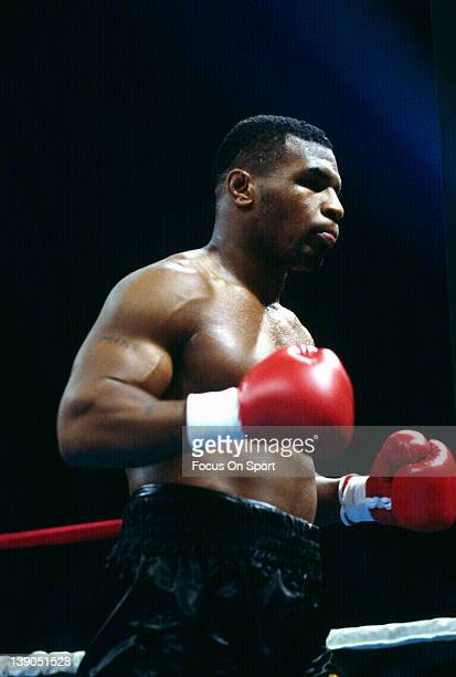 June 27: Heavyweight fighter Mike Tyson walks back to his corner during a scheduled twelve round WBC, WBA, IBF heavyweight title fight against...