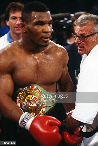 Heavyweight fighter Mike Tyson wears the WBC title belt after defeating Trevor Berbick by TKO in the second round of a scheduled twelve round WBC...