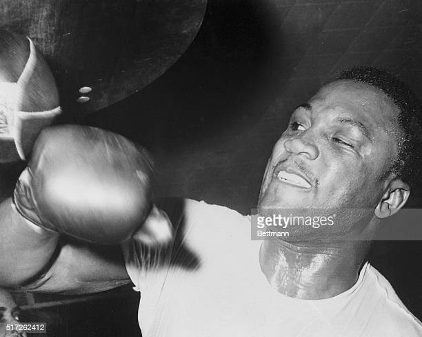 Heavyweight Joe Frazier punches the bag during a workout for his title bout with Buster Mathis at the new Madison Square Garden.