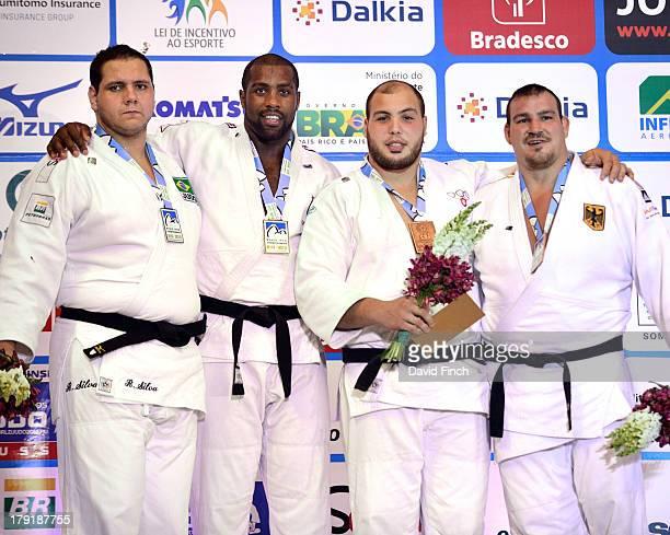 Heavyweight medal ceremony Silver Rafael Silva BRA Gold Teddy Riner FRA Bronzes Faicel Jaballah TUN and Andreas Toelzer GER during the Rio World Judo...