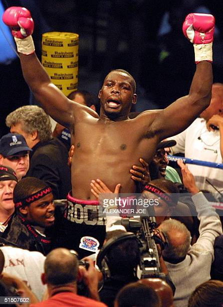 Heavyweight new champion of the world Hasim Rahman celebrates his victory over British former champion Lennox Lewis, 21 April 2001 after their title...