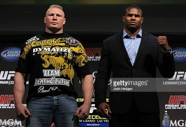 Heavyweight opponents Brock Lesnar and Alistair Overeem pose for photos after the UFC 141 Lesnar v Overeem onsale press conference at the Santa...