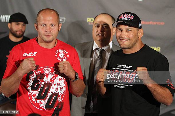 Heavyweight opponents Fedor Emelianenko and Dan Henderson pose for photos at the Strikeforce Fedor vs Henderson prefight press conference at Harry...