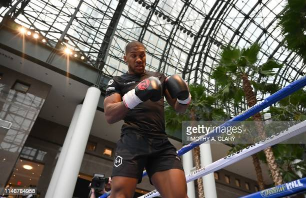 Heavyweight world champion Anthony Joshua from England looks on during a workout at Brookfield Place in the Financial District of New York May 28 on...