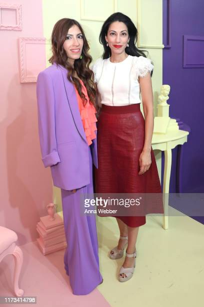 Heba Abedin and Huma Abedin attend the alice olivia by Stacey Bendet Spring 2020 Fashion Presentation at Root Studio on September 09 2019 in New York...