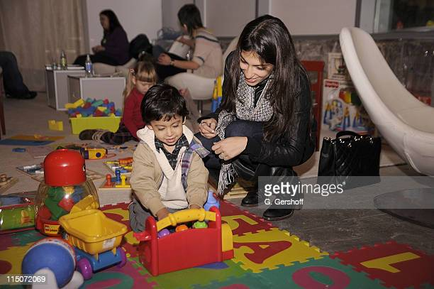 Heba Abedin with son Noah Abedin attend the 2009 Baby Buggy Gear Drive at Baby Buggy Boutique on December 5 2009 in New York City