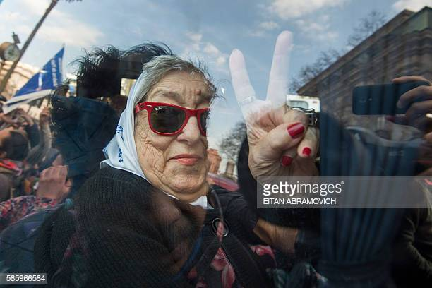 Hebe de Bonafini leader of the Mothers of Plaza de Mayo hunan rights organization flashes the v sign as she leaves Plaza de Mayo square in Buenos...