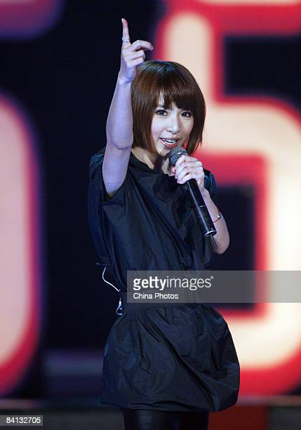 Hebe Of Taiwanese singing group SHE performs after receiving the Most Popular Searched Singing Group and the Best Selling Singing Group Awards during...