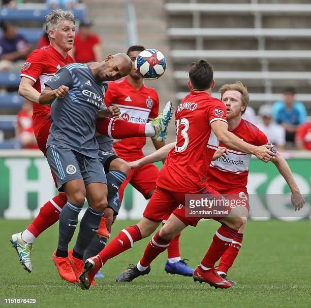 Heber of New York City heads the ball surrounded by Bastian Schweinsteiger , Brandt Bronico and Dax McCarty of Chicago Fire at SeatGeek Stadium on...