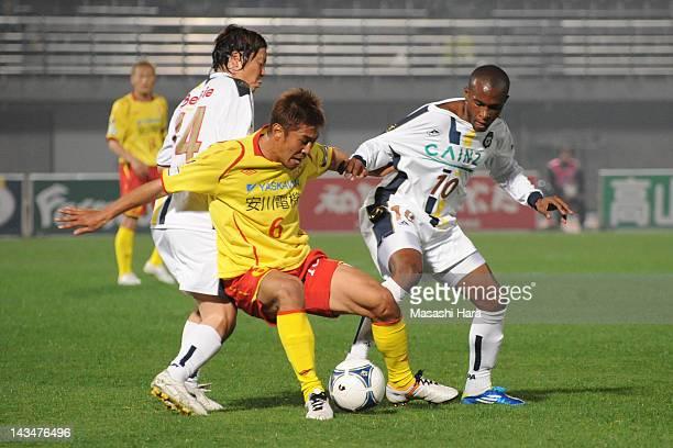 Heberty Shingo Kumabayashi of Thespa Kusatsu and Yuki Fuji of Giravanz Kitakyushu compete for the ball during the JLeague Second Division match...