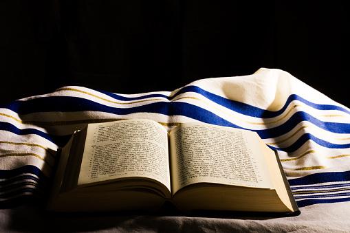 Hebrew Bible and a tallit, a jewish prayer shawl 1141398851
