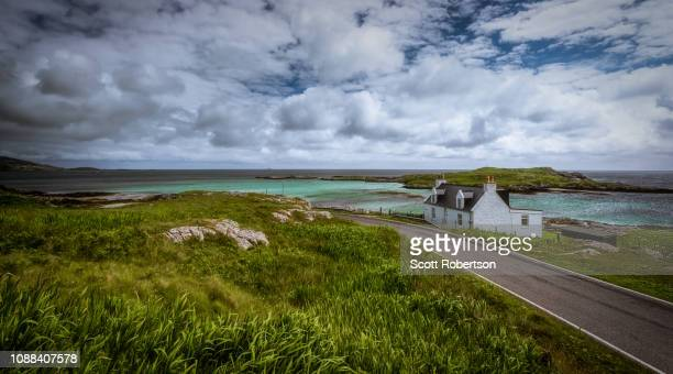 hebridean house by the sea. - barra scotland stock pictures, royalty-free photos & images