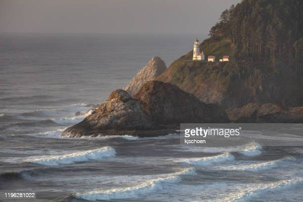 heceta head lightouse and waves at sunset - oregon coast stock pictures, royalty-free photos & images