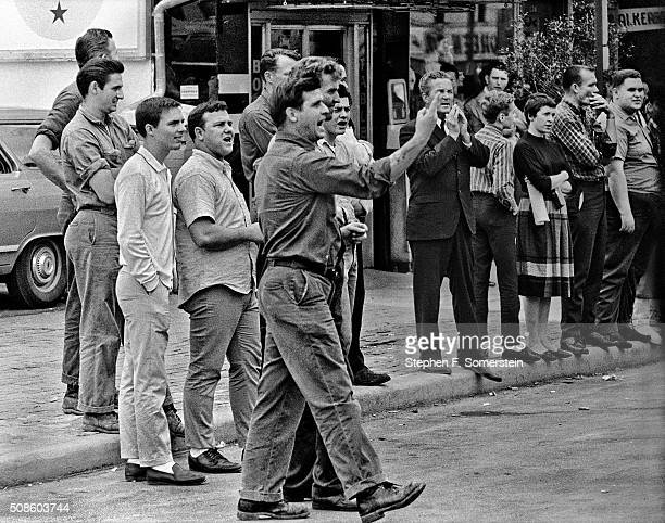 Hecklers make their opinions known to marchers as they pass by during the Selma to Montgomery Civil Rights March on March 25, 1965 in Montgomery,...