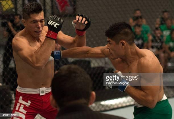 Hector Aldana punches Alvaro Herrera during the filming of The Ultimate Fighter Latin America Team Gastelum vs Team Escudero on April 10 2015 in Las...