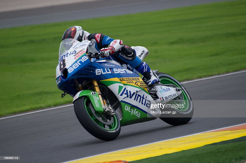 Hector Barbera of Spain and Avintia Blusens rounds the bend during the second day of pre season MotoGP testing at Ricardo Tormo Circuit on November 14, 2012 in Valencia, Spain.
