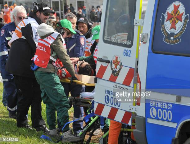 Hector Barbera of Spain is loaded into an ambulance after crashing heavily during the first practice session for the Australian 250cc Motorcycle...