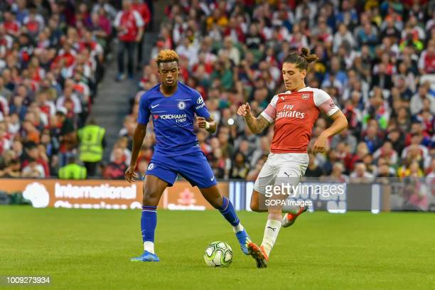 Hector Belarin of Arsenal plays away from Callum HudsonOdoi of Chelsea during the Chelsea v Arsenal International Champions Cup in Aviva Stadium