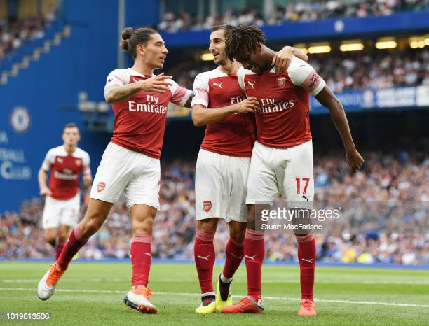 Hector Belleirn and Henrikh Mkhitaryan celebrate the 2nd Arsenal goal scored by Alex Iwobi during the Premier League match between Chelsea FC and...