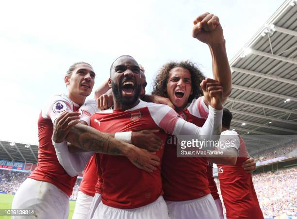 Hector Bellerin, Alex Lacazette and Matteo Guendouzi celebrate the 2nd Arsenal goal during the Premier League match between Cardiff City and Arsenal...