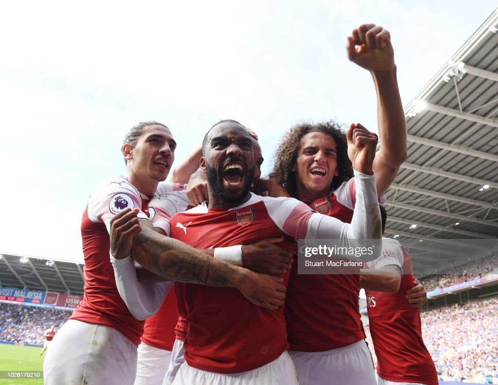 Hector Bellerin, Alex Lacazette and Matteo Guendouzi celebrates the 2nd Arsenal goal, scored by Pierre-Emerick Aubmeyang during the Premier League match between Cardiff City and Arsenal at Cardiff City Stadium on September 2, 2018 in Cardiff, United Kingdom.