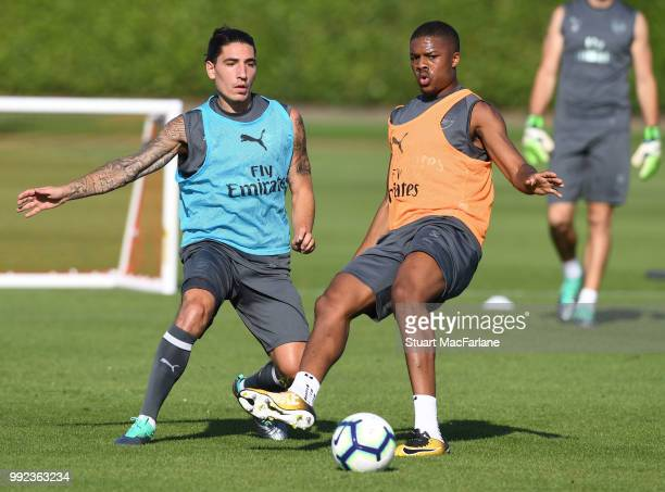 Hector Bellerin and Chuba Akpom of Arsenal during a training session at London Colney on July 5 2018 in St Albans England