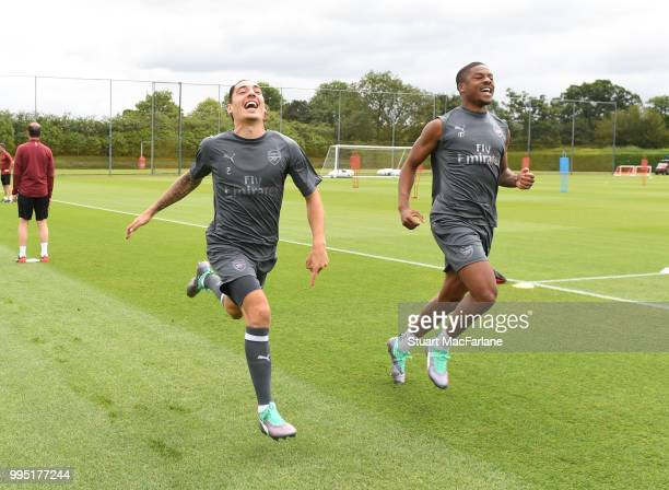 Hector Bellerin and Chuba Akpom of Arsenal during a training session at London Colney on July 10 2018 in St Albans England