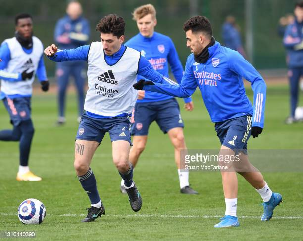 Hector Bellerin and Dani Ceballos of Arsenal during a training session at London Colney on April 02, 2021 in St Albans, England.