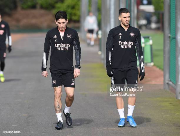Hector Bellerin and Dani Ceballos of Arsenal during a trining session at London Colney on February 24, 2021 in St Albans, England.