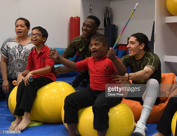 Hector Bellerin and Danny Welbeck of Arsenal during a visit to the Rashid Centre for The Determined Ones on March 25, 2019 in Dubai, United Arab...