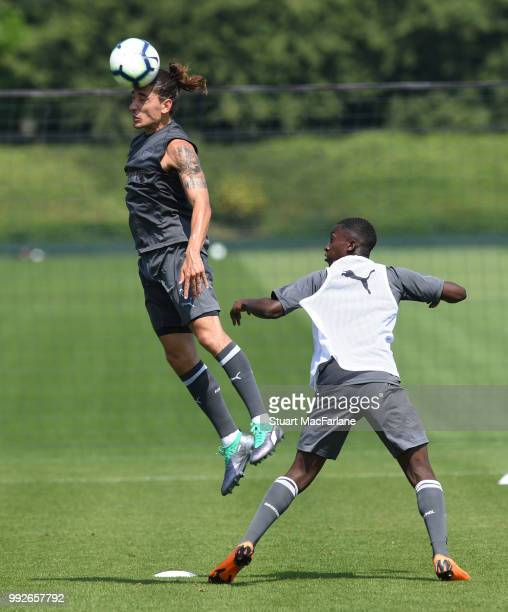 Hector Bellerin and Eddie Nketiah of Arsenal during a training session at London Colney on July 6 2018 in St Albans England