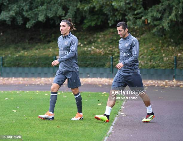Hector Bellerin and Henrikh Mkhitaryan of Arsenal before a training session at London Colney on August 10 2018 in St Albans England
