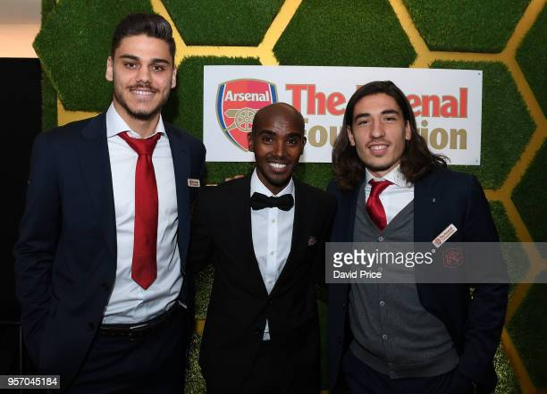 Hector Bellerin and Konstantinos Mavropanos of Arsenal with Athlete Mo Farah at the Arsenal Foundation Charity Ball at Emirates Stadium on May 10...