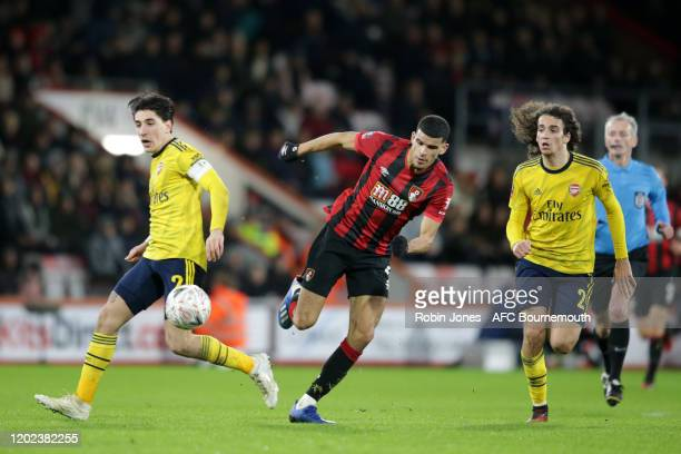 Hector Bellerin and Matteo Guendouzi of Arsenal compete for the ball with Dominic Solanke of Bournemouth during the FA Cup Fourth Round match between...