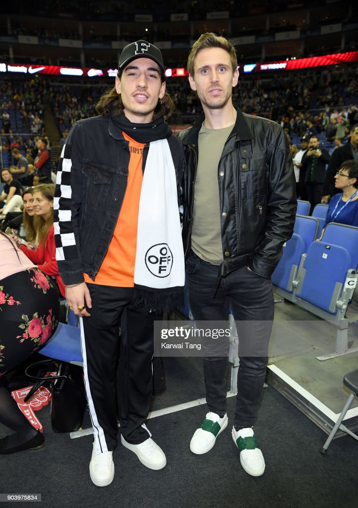 Hector Bellerin and Nacho Monreal attend the Philadelphia 76ers and Boston Celtics NBA London game at The O2 Arena on January 11, 2018 in London, England.