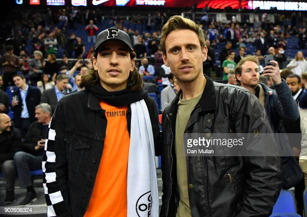 Hector Bellerin and Nacho Monreal of Arsenal attend the NBA game between Boston Celtics and Philadelphia 76ers at The O2 Arena on January 11 2018 in...