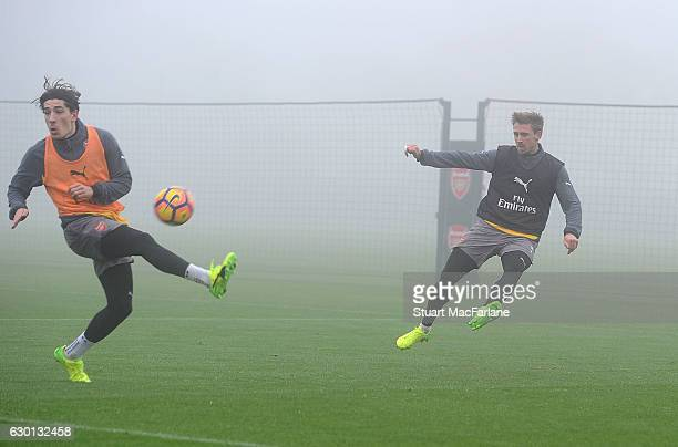 Hector Bellerin and Nacho Monreal of Arsenal during a training session at London Colney on December 17 2016 in St Albans England
