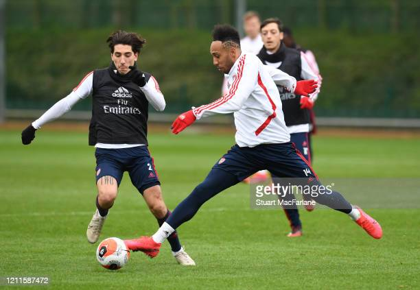 Hector Bellerin and PierreEmerick Aubameyang of Arsenal during a training session at London Colney on March 10 2020 in St Albans England