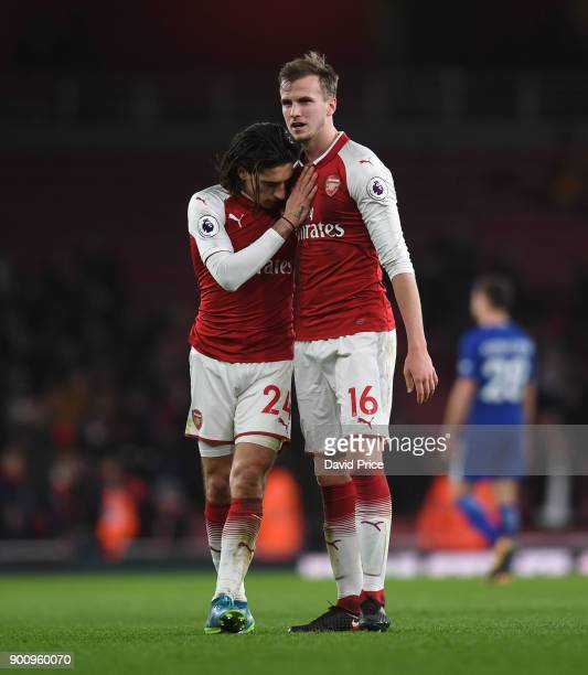 Hector Bellerin and Rob Holding of Arsenal after the Premier League match between Arsenal and Chelsea at Emirates Stadium on January 3 2018 in London...