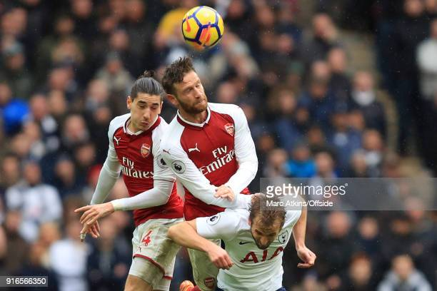Hector Bellerin and Shkodran Mustafi of Arsenal in action with Harry Kane of Tottenham Hotspur during the Premier League match between Tottenham...