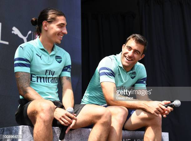 Hector Bellerin and Sokratis Papastathopouplos of Arsenal launch the new Arsenal Puma 3rd kit at Esplande Theatres on the Bay on July 27 2018 in...