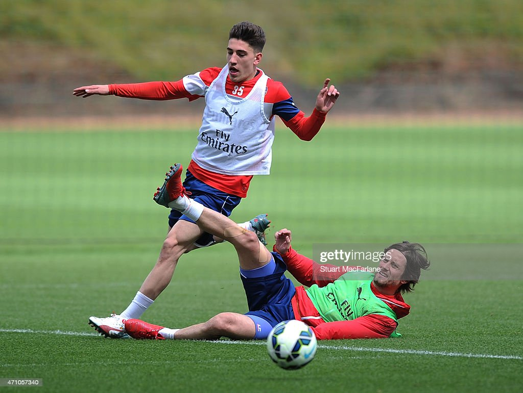 Hector Bellerin and Tomas Rosicky of Arsenal during a training session at London Colney on April 25, 2015 in St Albans, England.