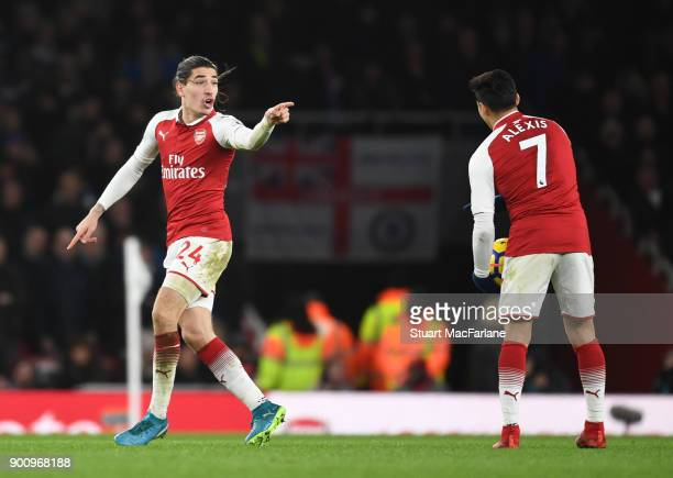 Hector Bellerin celebrates scoring the 2nd Arsenal goal with Alexis Sanchez during the Premier League match between Arsenal and Chelsea at Emirates...