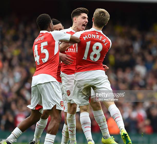 Hector Bellerin celebrates scoring the 3rd Arsenal goal with Alex Iwobi and Naco Monreal during the Barclays Premier League match between Arsenal and...