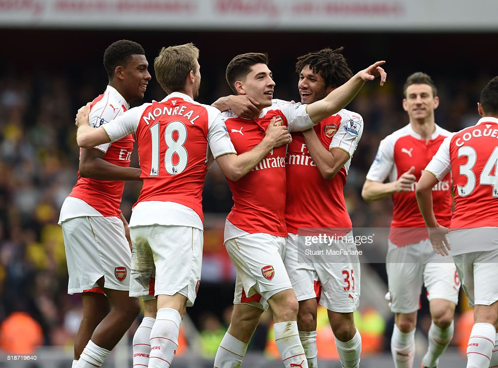 Hector Bellerin celebrates scoring the 3rd Arsenal goal with (L) Nacho Monreal and (R) Mohamed Elneny during the Barclays Premier League match between Arsenal and Watford at Emirates Stadium on April 2, 2016 in London, England.