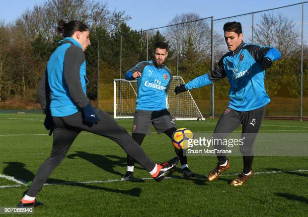 Hector Bellerin Mathieu Debuchy and Konstantinos Mavropanos of Arsenal during a training session at London Colney on January 19 2018 in St Albans...